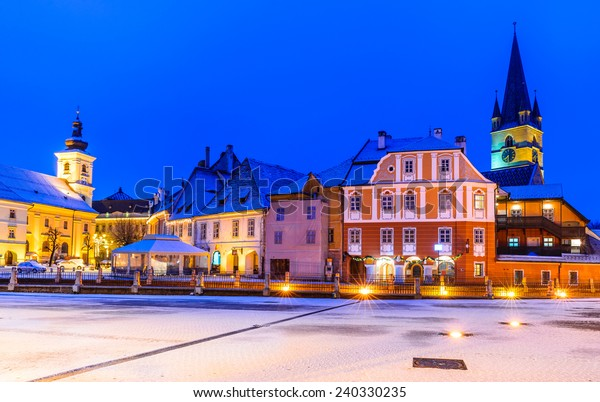 Sibiu, Transylvania. Evangelical Cathedral dominates Small Square with Huet Square, medieval Saxon city of Sibiu, Romania.