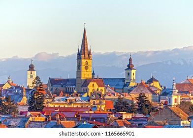 Sibiu, Transylvania, Romania, cityscape in winter with Carpathians mountains in background
