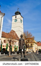 SIBIU, TRANSYLVANIA, ROMANIA - OCTOBER 2013: Statue of Gheorghe Lazar, Romanian scholar, in front of the Council Tower of Sibiu  (Romanian: Turnul Sfatului, German: Hermannstadter Ratsturm).