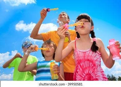 Siblings blowing bubbles