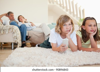 Siblings are bored by tv program