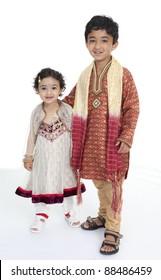 Siblings Display Traditional Indian Costumes