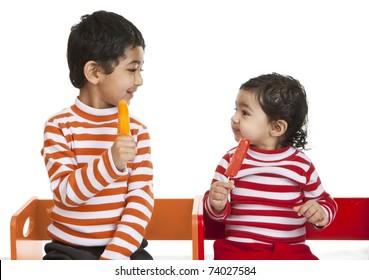Siblings Enjoying Popsicles