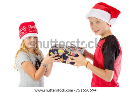 Siblings exchange a christmas present isolated on white background