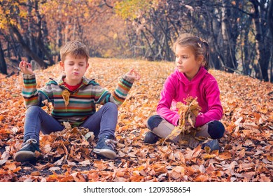 Siblings having fun in autumnal forest