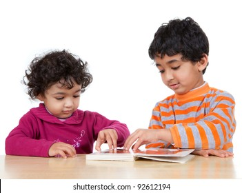 Siblings Reading a Picture Book Together, Isolated, White