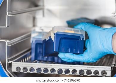 Sicentist sterilizing laboratory material in autoclave
