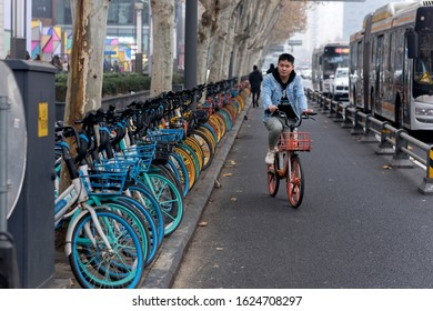 Chengdu, Sichuan / China - December 12 2019: shared bikes near a bus station in Chengdu. Shared economy has become prosperous since 2015.