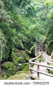 SICHUAN, CHINA - May 18 2016: Longyinxia Plank Road at Mount Qingcheng (Hou Shan) in Dujiangyan, Sichuan, China. a famous UNESCO World Heritage site.