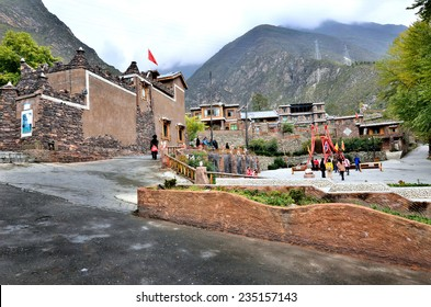 Sichuan, China - October 27, 2013 :There are some tourists and villagers walking around the Pingtou Qiang Village which is located at Maoxian