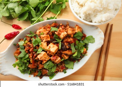 sichuan mapo tofu, chinese food over wooden table background