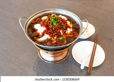 Sichuan spicy boiled fish hot pot with red hot spicy chilli. Asia China Chongqing Chengdu food.