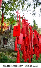 Sichuan,China - October 27, 2013 :The tourists can make a wish on the wishes plate which selling in the Pingtou Qiang Culture Village,Maoxian Sichuan China