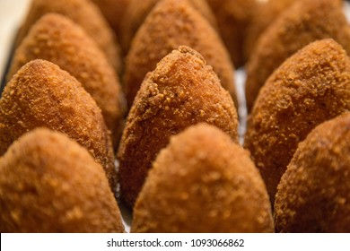 """Sicilian """"Arancino"""" a typical street food from Sicily in Italy. Delicious rice balls made with fried rice."""