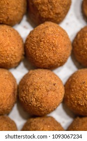 """Sicilian """"Arancino"""" a typical street food from Sicily. Delicious rice balls made with fried rice."""