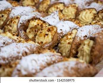 Sicilian cannoli with sweet ricotta, with chocolate chips and icing sugar. Traditional italian dessert with ricotta cheese.