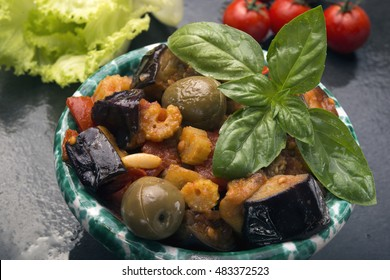 Sicilian eggplant caponata is a salad with tomatoes vinegar pine nuts caper celery onions olive oils weet and sour sauce