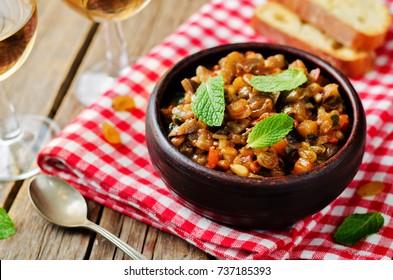 Sicilian Eggplant pine nuts Caponata. toning. selective focus