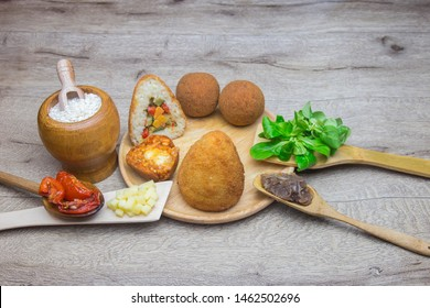 Sicilian food « Arancino », a typical street food from Sicily in Italy. Arancini, the delicious rice balls made with fried rice.