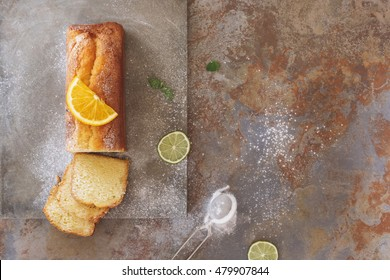 Sicilian orange cake with orange slice on top . Top view, blank space, vintage toned image