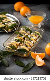Sicilian recipe anchovies rolls - Alici al beccafico - cooked with orange juice on the wooden skewers