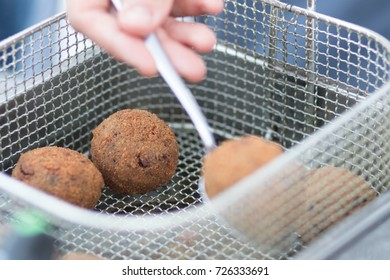 Sicily: cooking of the arancino, a typical street food