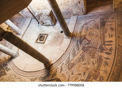"""SICILY, ITALY - JULY 30, 2013 Piazza Armerina : Archaeological site of """"Villa Romana del Casale"""". Detail of a room with famous Roman mosaics. The site has been declared by UNESCO """"World Heritage"""""""