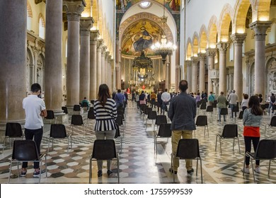 Sicily, Italy - May 31, 2020: Holy mass in Christian church during the coronavirus pandemic Covid-19.