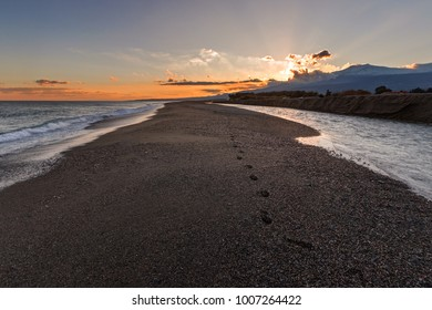 Sicily, Italy: the sea at Alcantara river's mount at sunset: Etna volcano on background.