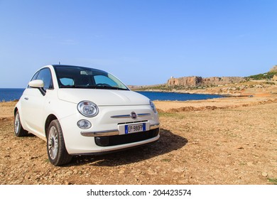 SICILY - JUNE 29: Rented Fiat 500 near the seaside on June 29, 2014 in Sicily. Fiat 500 is most popular car offered by rent a car companies in Sicily.