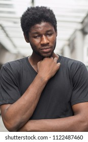 sick african man with sore throat; portrait of man suffering from cold, flu, sickness with sore throat inflammation; man health care, body care, sickness, pain concept; young adult african man model