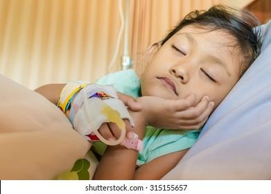 Sick Asian Ethnic Little Girl Inpatient Sleeping in Hospital Room