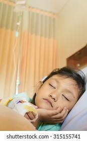 Sick Asian Ethnic Little Girl Patient Sleeping in Hospital Room