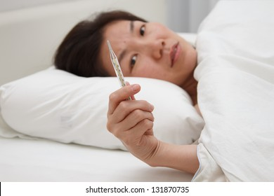 sick asian girl with high fever