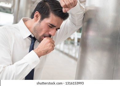 sick asian man coughing; portrait of sick, ill asian indian man with sore throat