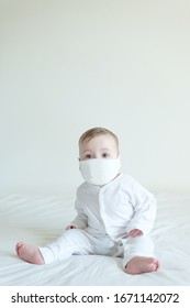 Sick baby wearing a mask