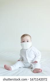 Sick baby wearing a mask