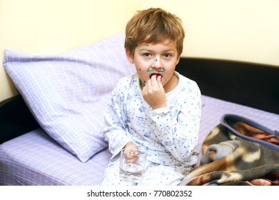 Sick boy infectious disease . The child is lying in bed