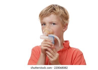 Sick boy inhales some medicine on white background