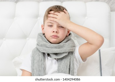Sick boy on the bed checks the temperature at home. Empty space for text