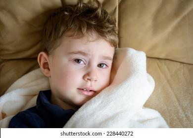 Sick boy under the blanket