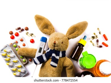 sick Bunny with thermometer, pills and medicine