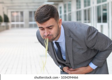 Sick businessman throwing up in the office