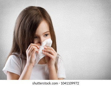 A sick child with a handkerchief
