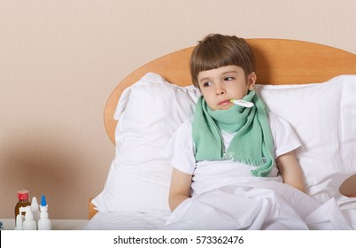 Sick child of six years old is lying in his bed.