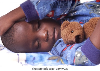 Sick child sleeping with his teddy bear