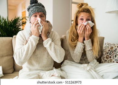 Sick couple catch cold. Man and woman sneezing, coughing. People got flu, having runny nose.