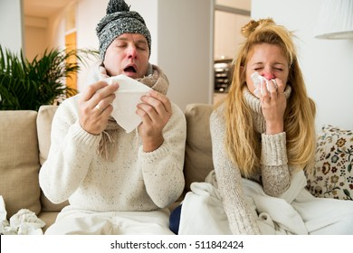 Sick couple catch cold. Man and woman sneezing, coughing. People got flu, having runny nose.  - Shutterstock ID 511842424