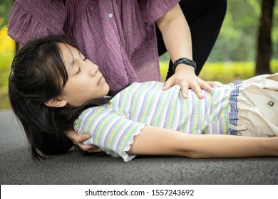 Sick daughter is fainted and fallen on floor while playing and exercise,asian mother help,take care, child girl with congestive heart failure,female unconscious fell to the ground suffer heart attack