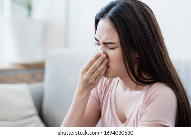 Sick fever asian woman use tissue blow a nose with tired face. Healthy, medicine taking, Respiratory disease, sickness, cold, health care, allergy, pharmacy, coronavirus, covid-19 prevent concept.